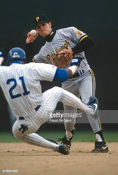 Jay Bell of the Pittsburgh Pirates looks to get his throw off over the top of Sammy Sosa of the Chicago Cubs during an Major League Baseball game...