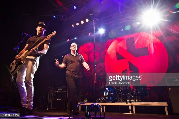 Jay Bentley and Greg Graffin of the American band Bad Religion perform live on stage during a concert at the Huxleys on July 11 2017 in Berlin Germany
