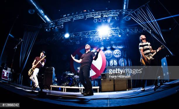 Jay Bentley Greg Graffin and Brian Baker of the American band Bad Religion perform live on stage during a concert at the Huxleys on July 11 2017 in...