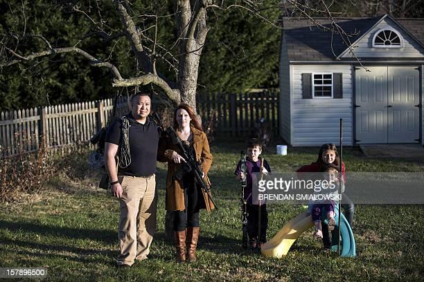 Jay Blevins and his wife Holly Blevins and their children Samuel Benjamin Blevins Elliana Grace Blevins and Evangeline Joy Blevins pose beneath one...