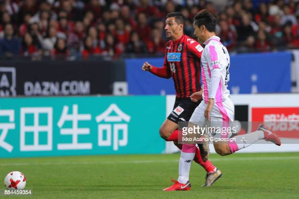 Jay Bothroyd of Consadole Sapporo and Jung Seung Hyun of Sagan Tosu compete for the ball during the JLeague J1 match between Consadole Sapporo and...