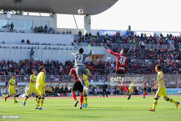 Jay Bothroyd of Consadole Sapporo and Kosuke Nakamura compete for the ball for scoring his side's second goal during the J.League J1 match between...
