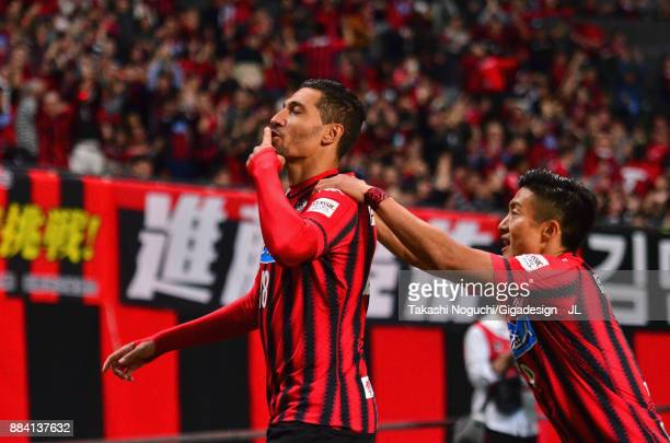 Jay Bothroyd of Consadole Sapporo celebrates scoring the opening goal with his team mate Ken Tokura during the JLeague J1 match between Consadole...