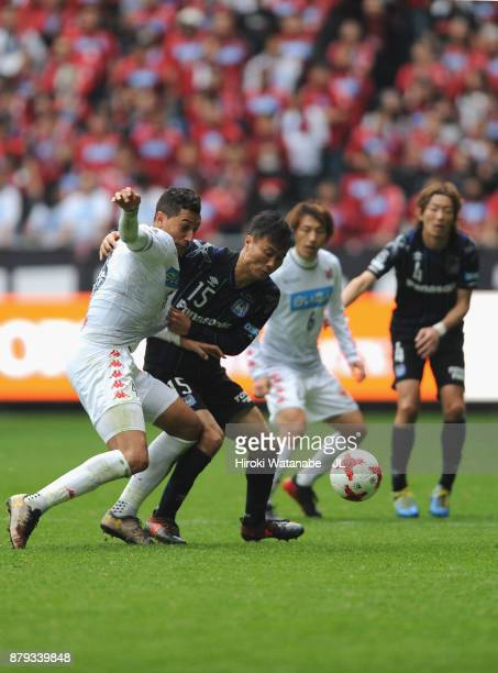 Jay Bothroyd of Consadole Sapporo controls the ball under pressure of Yasuyuki Konno of Gamba Osaka during the JLeague J1 match between Gamba Osaka...