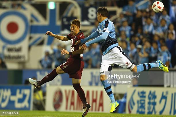 Jay Bothroyd of Jubilo Iwata and Masahiko Inoha of Vissel Kobe compete for the ball during the JLeague Yamazaki Nabisco Cup match between Jubilo...