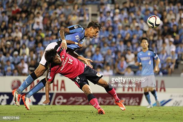 Jay Bothroyd of Jubilo Iwata and Yusuke Maruhashi of Cerezo Osaka compete for the ball during the J.League second division match between Jubilo Iwata...