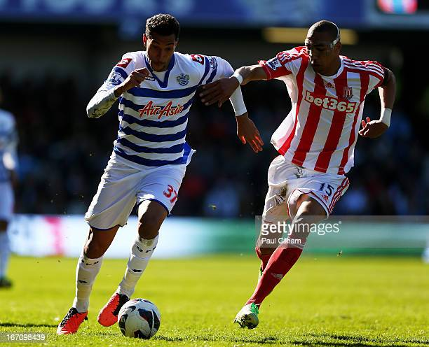 Jay Bothroyd of QPRvis pursued by Steven Nzonzi of Stoke during the Barclays Premier League match between Queens Park Rangers and Stoke City at...
