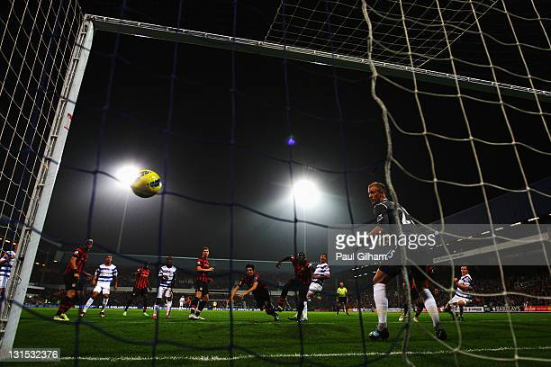 Jay Bothroyd of Queens Park Rangers rises above the Manchester City defence to score past goalkeeper Joe Hart during the Barclays Premier League...