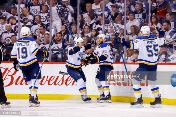 Jay Bouwmeester Brayden Schenn Ryan O'Reilly and Colton Parayko of the St Louis Blues celebrate a third period goal against the Winnipeg Jets in Game...