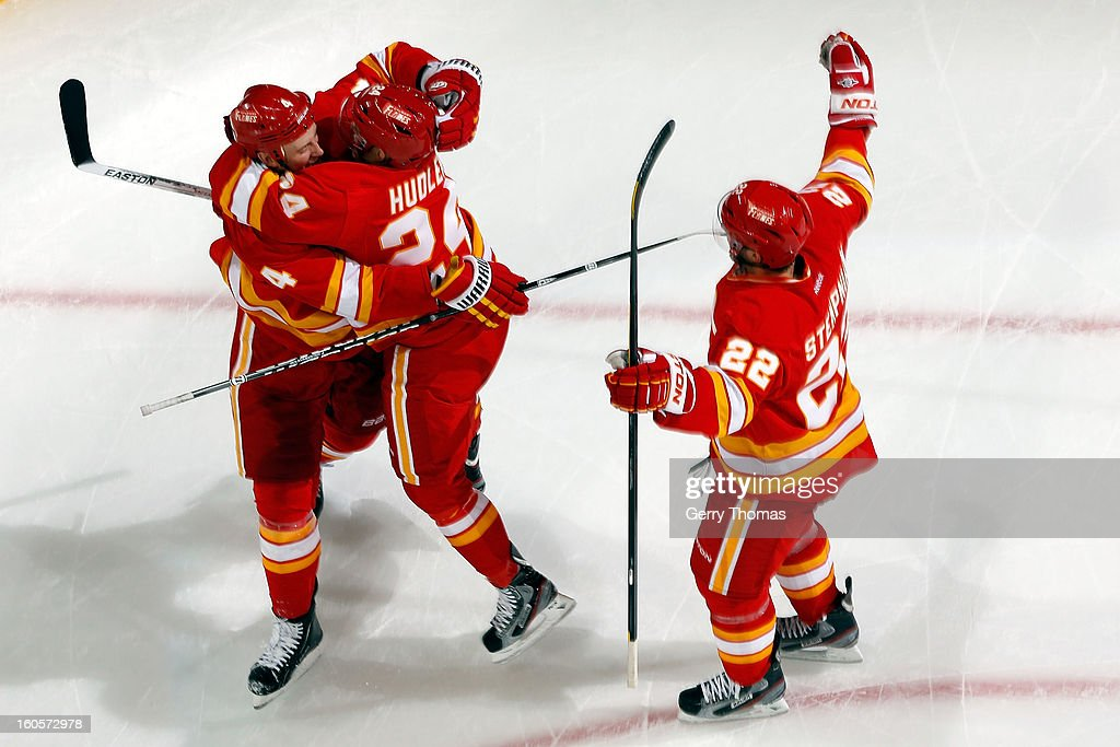 Jay Bouwmeester #4, Jiri Hudler #24 and Lee Stempniak #22 of the Calgary Flames celebrate a goal against the Chicago Blackhawks on February 2, 2013 at the Scotiabank Saddledome in Calgary, Alberta, Canada.