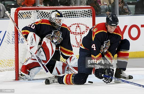 Jay Bouwmeester of the Florida Panthers drops down in front of goaltender Ed Belfour to block a shot against the New York Rangers at Bank Atlantic...