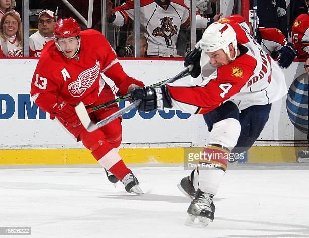 Jay Bouwmeester of the Florida Panthers takes a slap shot next to Pavel Datsyuk of the Detroit Red Wings during a NHL game on December15 2007 at Joe...