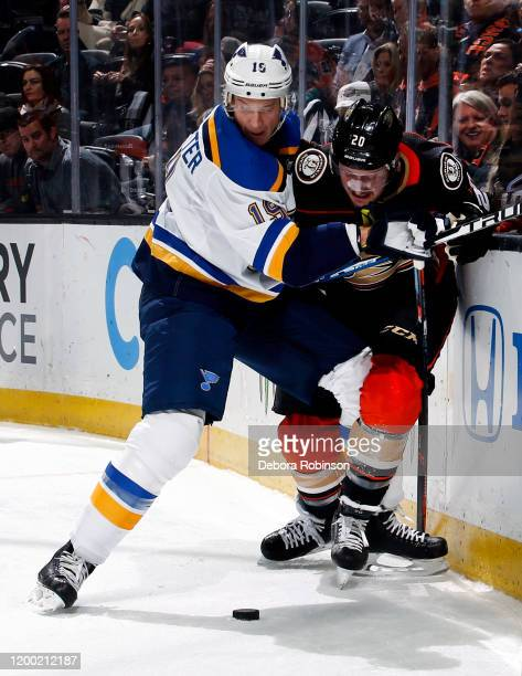 Jay Bouwmeester of the St Louis Blues battles for the puck against Nicolas Deslauriers of the Anaheim Ducks during the game at Honda Center on...