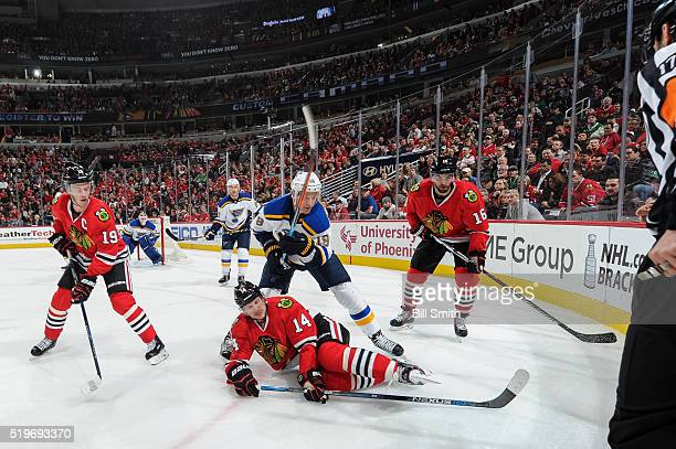 Jay Bouwmeester of the St. Louis Blues chases after the puck against Jonathan Toews, Richard Panik and Andrew Ladd of the Chicago Blackhawks in the...