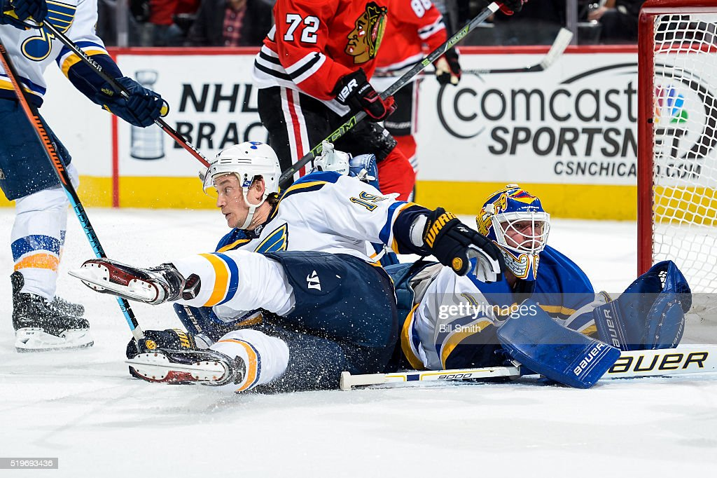 Jay Bouwmeester #19 of the St. Louis Blues slides into goalie Brian Elliott #1 in the first period of the NHL game against the Chicago Blackhawks at the United Center on April 7, 2016 in Chicago, Illinois.