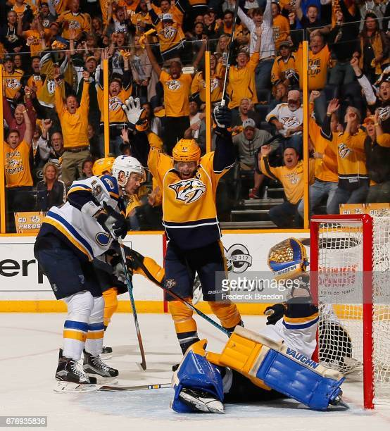 Jay Bouwmeester of the St Louis Blues watches Mike Fisher of the Nashville Predators celebrate after a goal against goalie Jake Allen during the...