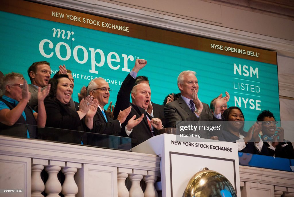 Jay Bray, chief executive officer and president of Nationstar Mortgage Holdings Inc., center, rings the opening bell during the company's rebranding to Mr. Cooper on the floor of the New York Stock Exchange (NYSE) in New York, U.S., on Monday, Aug. 21, 2017. U.S. stocks fluctuated after erasing early losses, while the dollar edged lower amidgrowing uneaseabout persistent low inflation and as investors await central bank speeches at Jackson Hole. Photographer: Michael Nagle/Bloomberg via Getty Images