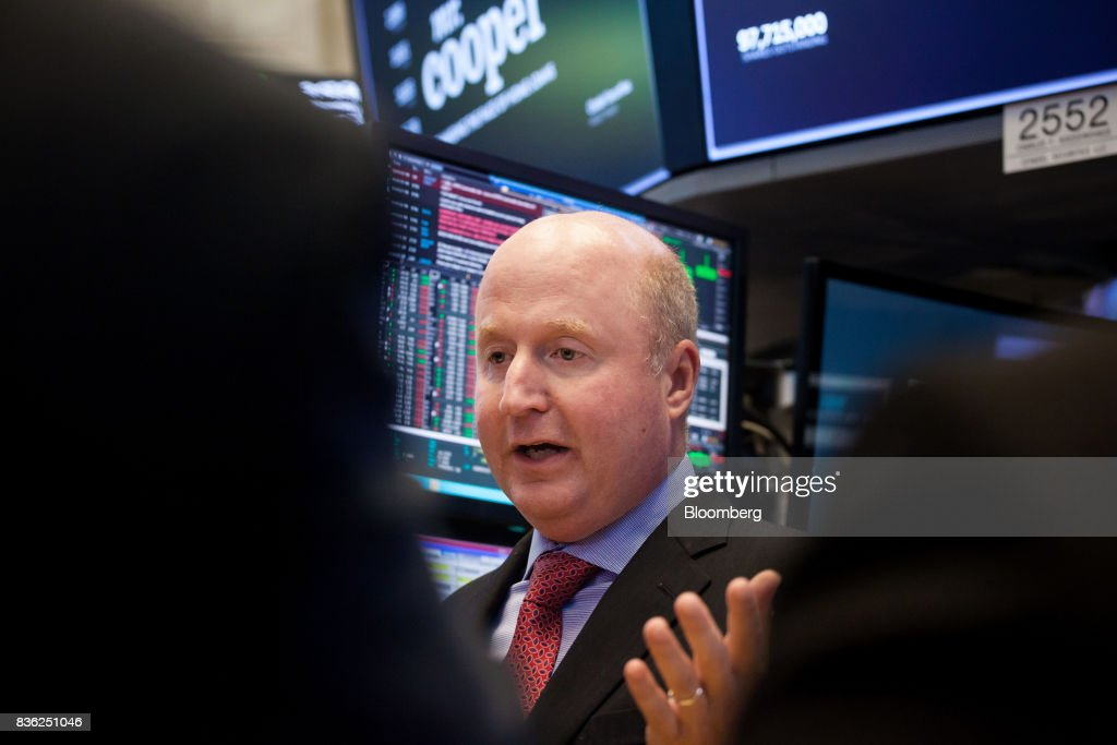 Jay Bray, chief executive officer and president of Nationstar Mortgage Holdings Inc., center, speaks during the company's rebranding to Mr. Cooper on the floor of the New York Stock Exchange (NYSE) in New York, U.S., on Monday, Aug. 21, 2017. U.S. stocks fluctuated after erasing early losses, while the dollar edged lower amidgrowing uneaseabout persistent low inflation and as investors await central bank speeches at Jackson Hole. Photographer: Michael Nagle/Bloomberg via Getty Images