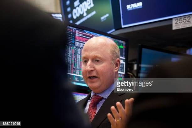 Jay Bray chief executive officer and president of Nationstar Mortgage Holdings Inc center speaks during the company's rebranding to Mr Cooper on the...