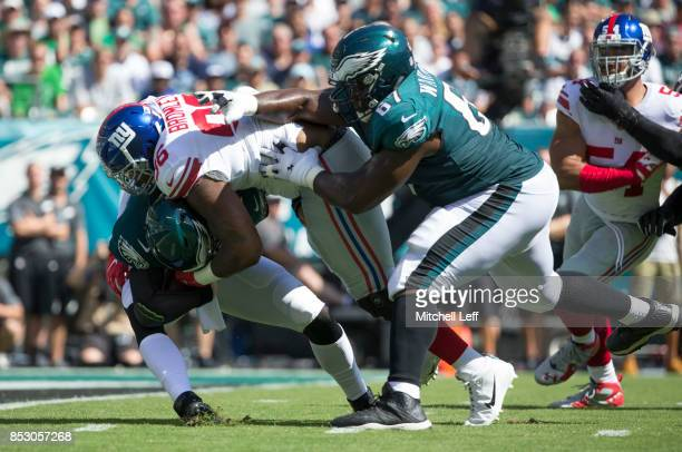 Jay Bromley of the New York Giants runs past Chance Warmack of the Philadelphia Eagles and sacks Carson Wentz in the first quarter at Lincoln...