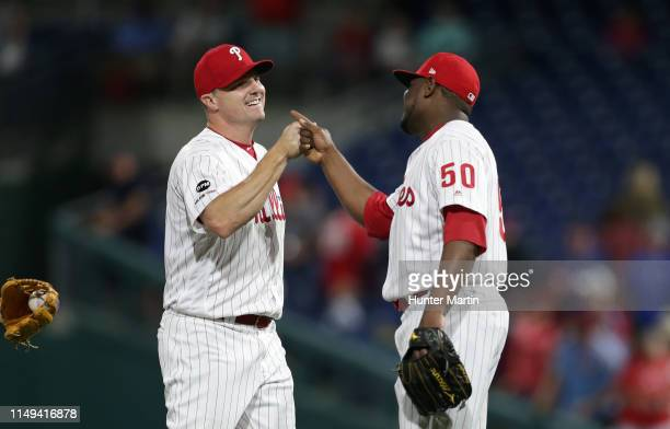 Jay Bruce and Hector Neris of the Philadelphia Phillies congratulate eachother after winning a game against the Arizona Diamondbacks at Citizens Bank...
