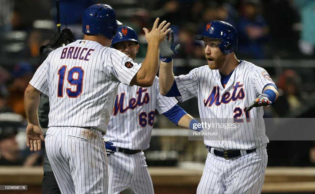Jay Bruce #19 and Jeff McNeil #68 congratulate Todd Frazier #21 of the New York Mets after he hit a three-run home run against the Philadelphia Phillies during the third inning of a game at Citi Field on September 8, 2018 in the Flushing neighborhood of the Queens borough of New York City. The Mets defeated the Phillies 10-5.