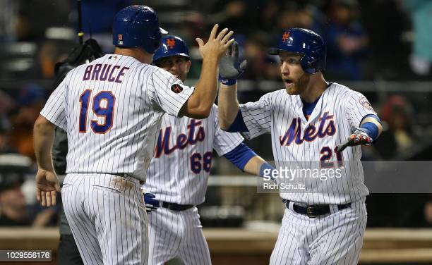 Jay Bruce and Jeff McNeil congratulate Todd Frazier of the New York Mets after he hit a threerun home run against the Philadelphia Phillies during...