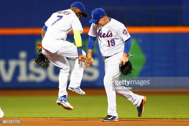 Jay Bruce and Jose Reyes of the New York Mets celebrate after defeating the San Francisco Giants 61 at Citi Field on May 9 2017 in the Flushing...