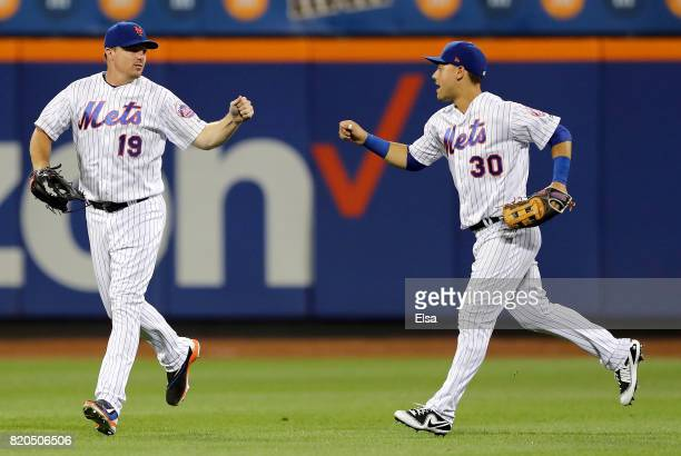 Jay Bruce and Michael Conforto of the New York Mets celebrate the 75 win over the Oakland Athletics on July 21 2017 at Citi Field in the Flushing...