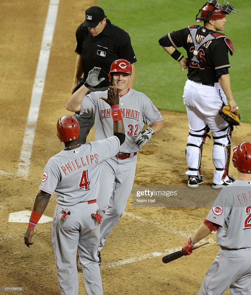 Jay Bruce #32 and teammate Brandon Phillips #4 of the Cincinnati Reds celebrate after Bruce hit his second home run of the game against the Arizona Diamondbacks at Chase Field on June 22, 2013 in Phoenix, Arizona.