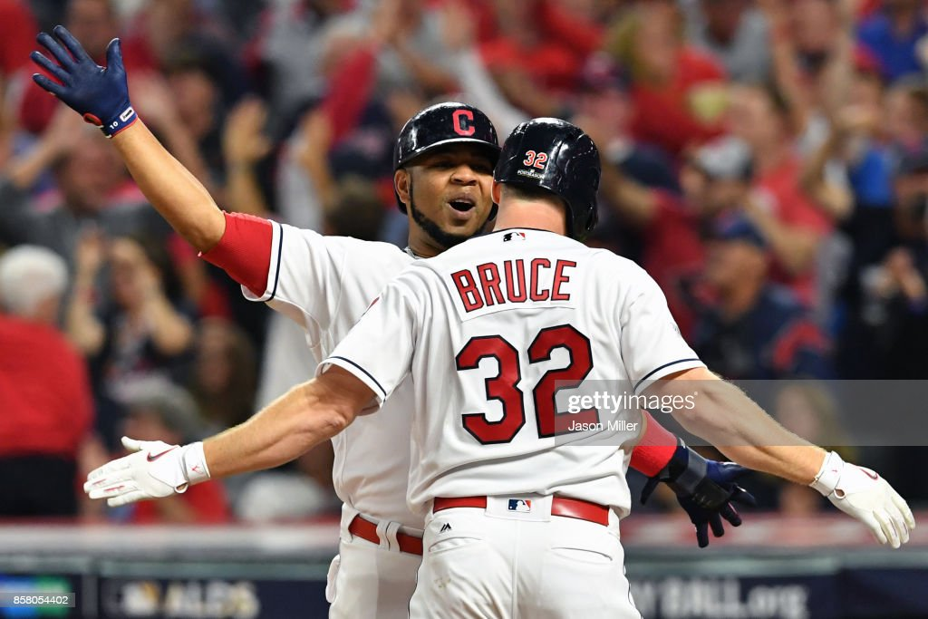 Jay Bruce #32 is congratulated by his teammate Edwin Encarnacion #10 of the Cleveland Indians after hitting a two-run home run during the fourth inning against the New York Yankees during game one of the American League Division Series at Progressive Field on October 5, 2017 in Cleveland, Ohio.