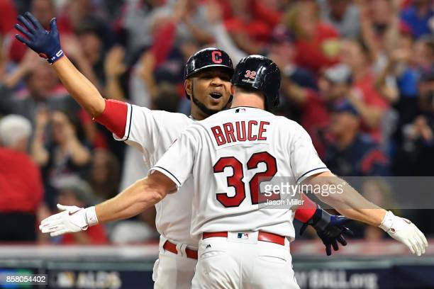 Jay Bruce is congratulated by his teammate Edwin Encarnacion of the Cleveland Indians after hitting a tworun home run during the fourth inning...