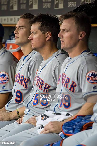 Jay Bruce Kelly Johnson and Brandon Nimmo of the New York Mets watch the action from the dugout in the third inning during a MLB game against the...