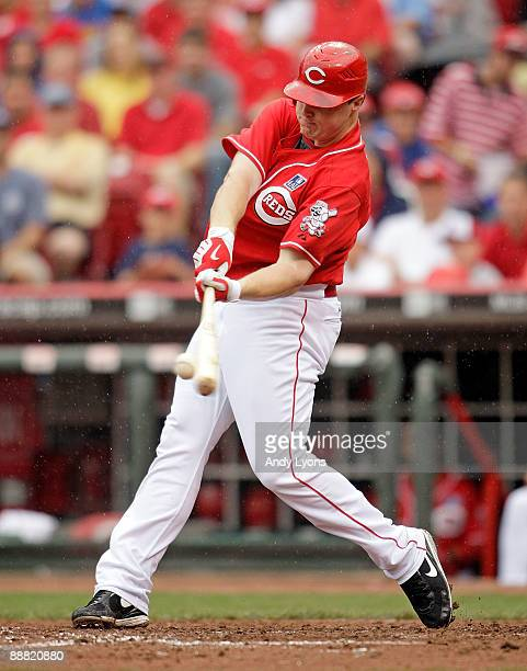 Jay Bruce of the Cincinnati Reds hits the ball during the game against the St. Louis Cardinals at the Great American Ball Park on July 4, 2009 in...