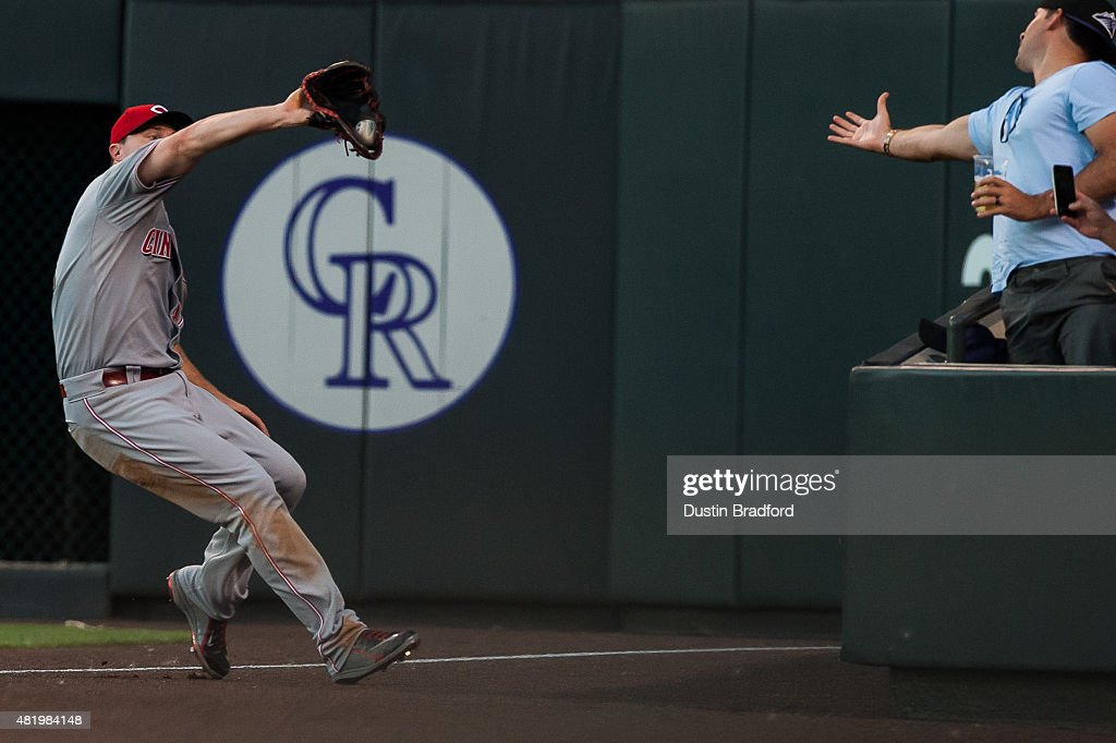 Jay Bruce #32 of the Cincinnati Reds makes a catch in foul territory against the Colorado Rockies in the sixth inning of a game at Coors Field on July 25, 2015 in Denver, Colorado.