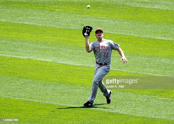 Jay Bruce of the Cincinnati Reds tracks down a fly ball against the Pittsburgh Pirates during the game on May 6 2012 at PNC Park in Pittsburgh...