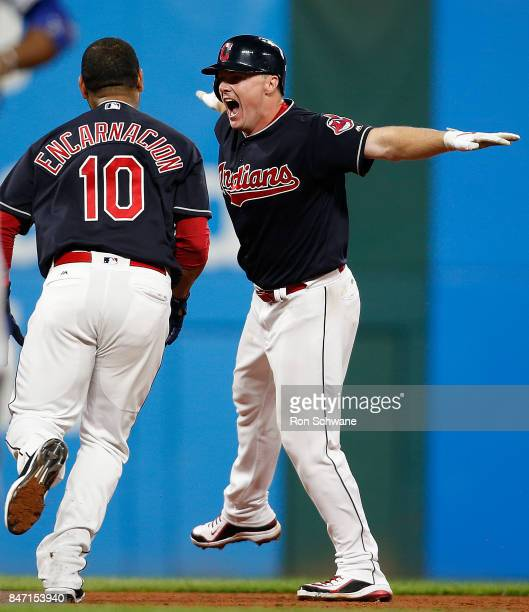 Jay Bruce of the Cleveland Indians celebrates wirh Edwin Encarnacion after hitting a game winning single off Brandon Maurer of the Kansas City Royals...