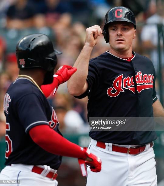 Jay Bruce of the Cleveland Indians celebrates with Abraham Almonte after scoring on Almonte's sacrifice fly off Jason Hammel of the Kansas City...