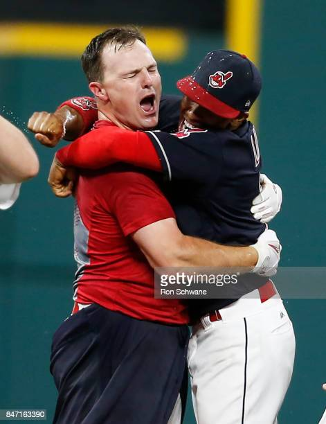 Jay Bruce of the Cleveland Indians celebrates with Francisco Lindor after hitting a game winning single off Brandon Maurer of the Kansas City Royals...