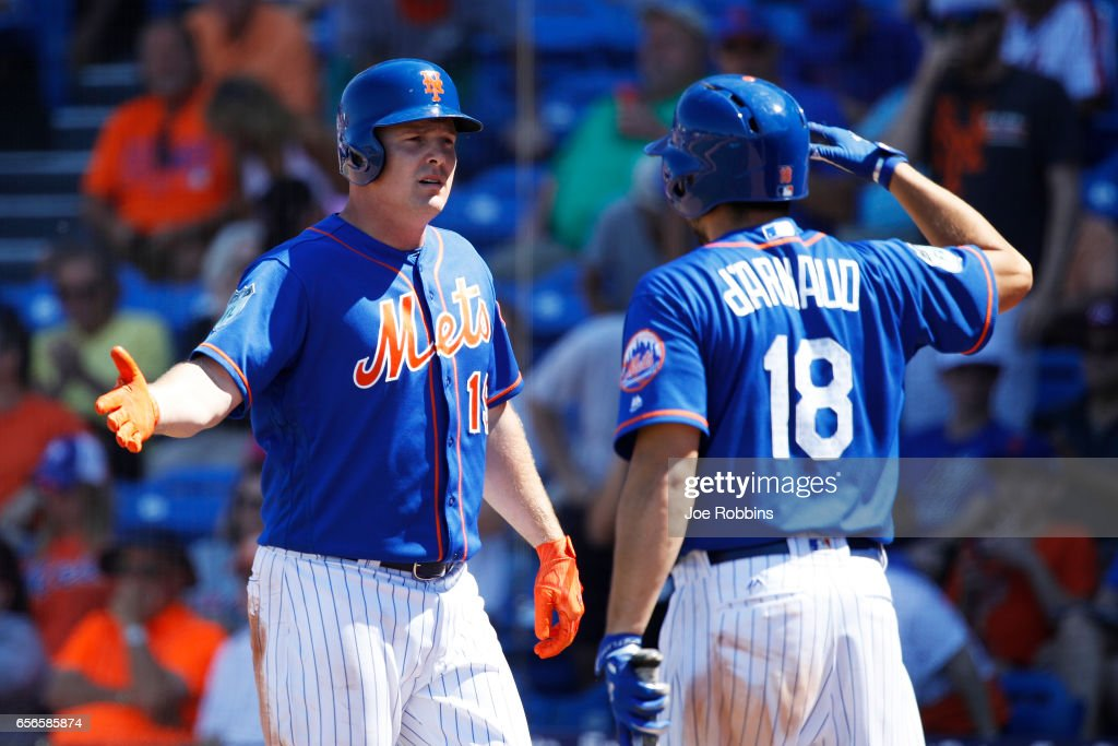Jay Bruce #19 of the New York Mets celebrates with Travis d'Arnaud #18 after hitting a home run in the fifth inning of a Grapefruit League spring training game against the Miami Marlins at Tradition Field on March 22, 2017 in Port St. Lucie, Florida. The Marlins defeated the Mets 15-9.