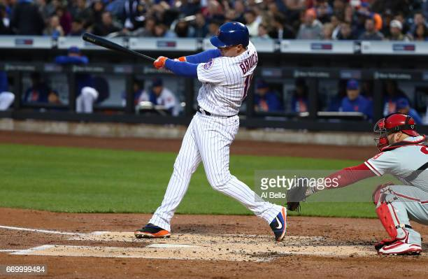 Jay Bruce of the New York Mets drives in a run with a hit in the first inning against the Philadelphia Phillies during their game at Citi Field on...