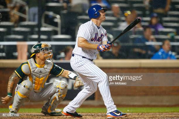 Jay Bruce of the New York Mets follows through on his sixth inning two run home run against the Oakland Athletics at Citi Field on July 22 2017 in...