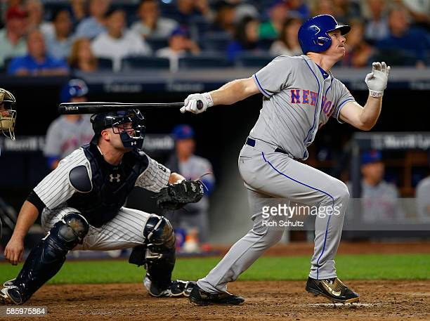 Jay Bruce of the New York Mets hits a three run home run against the New York Yankees during the fifth inning of a game at Yankee Stadium on August 4...