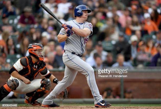 Jay Bruce of the New York Mets hits an rbi single scoring Curtis Granderson against the San Francisco Giants in the top of the eighth inning at ATT...