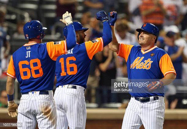 Jay Bruce of the New York Mets is congratulated by Jeff McNeil and Austin Jackson after he hit a tworun home run against the Washington Nationals...