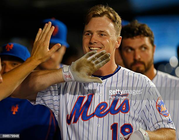 Jay Bruce of the New York Mets is congratulated by teammates after hitting a home run in the sixth inning against the Miami Marlins at Citi Field on...