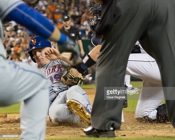 Jay Bruce of the New York Mets is tagged out at home plate in the ninth inning by catcher Jarrod Saltalamacchia of the Detroit Tigers to end the game...