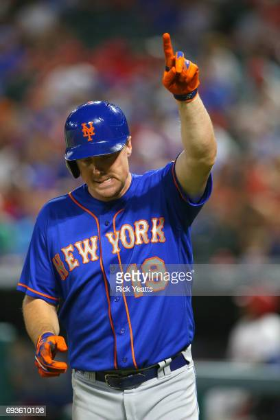 Jay Bruce of the New York Mets reacts after hitting a home run in the sixth inning against the Texas Rangers at Globe Life Park in Arlington on June...