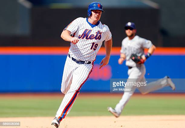 Jay Bruce of the New York Mets rounds third base and heads for home for a run in the eighth inning against the San Diego Padres at Citi Field on...