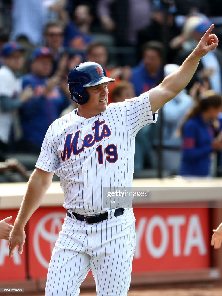Jay Bruce #19 of the New York Mets salutes teammate Lucas Duda #21 after Duda drove him in with a 3 RBI double in the seventh inning against the Atlanta Braves during Opening Day on April 3, 2017 at Citi Field in the Flushing neighborhood of the Queens borough of New York City.